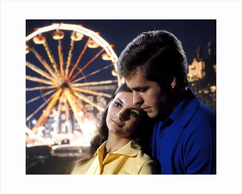1960 1960s 1970 1970s Couple Man Woman Romantic Head To Head Lights Of Ferris Wheel Amusement Park Background by Corbis