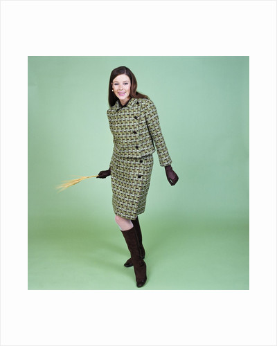 1960s Young Woman Modeling Green Wool Knit Two Piece Suit Fishnet Stockings Boots Full Length Clothes Retro by Corbis