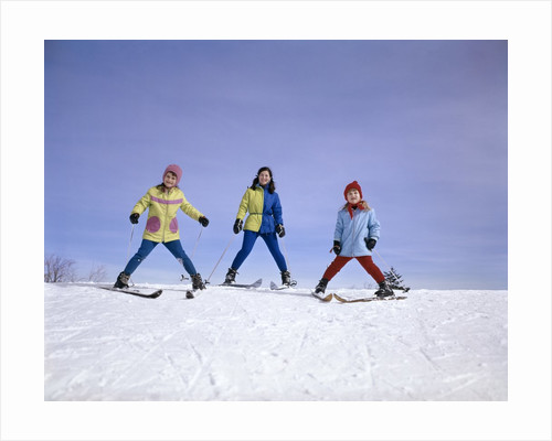 mother And Two Daughters Skiing Together Winter Outdoor by Corbis