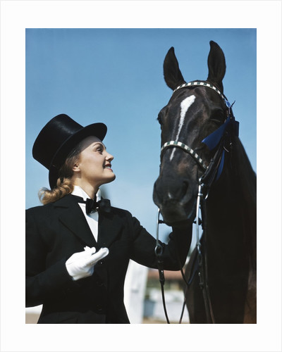 1940s 1950s Smiling Woman Wearing Top Hat Tuxedo White Gloves Holding Riding Crop Posing With Horse Blue Ribbon Winner by Corbis