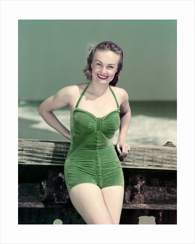 1940s Portrait Smiling Woman Wearing Green Velvet Bathing Suit Posing Leaning On Diving Board by Corbis
