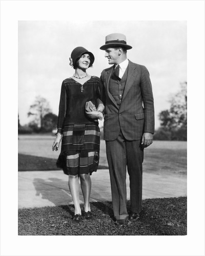 1920s Portrait Smiling Stylish Couple Walking Arm In Arm by Corbis