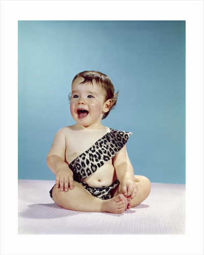 1960s Laughing Happy Baby Mouth Wide Open Wearing Leopard Print Tarzan Caveman Costume by Corbis
