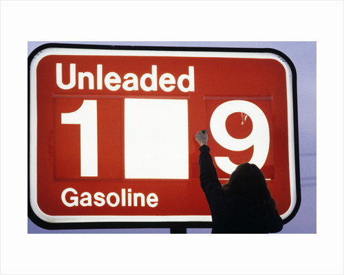 1980s Anonymous Unidentified Person Changing Gasoline Prices Sign by Corbis