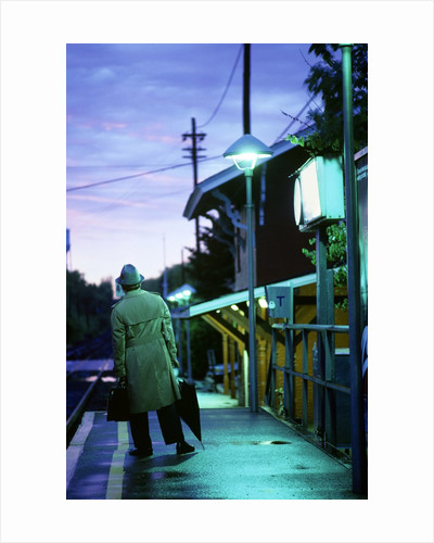 1970s 1980s Impatient Anonymous Man Waiting For Commuter Train by Corbis