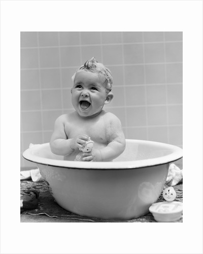 1940s Smiling Baby In Bath Covered In Soap Suds Laughing Holding Toy by Corbis