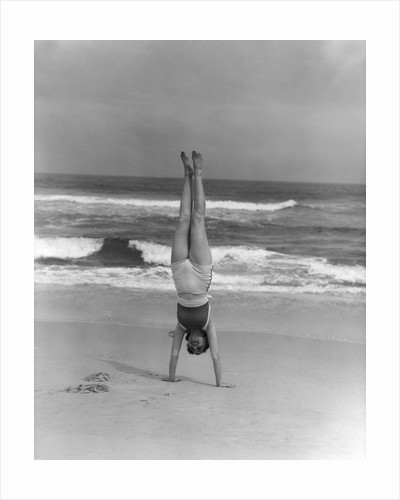 1930s Woman Doing Handstand On Beach Upside Down Exercise by Corbis