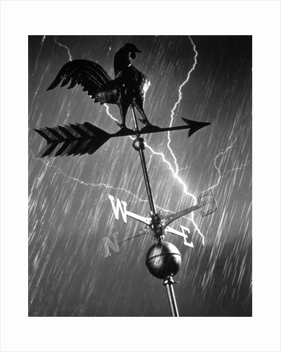 rooster Weathervane In Rain And Lightning Storm by Corbis