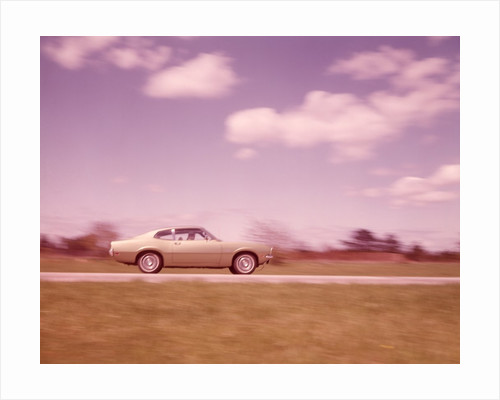1960s Blurred Motion Of Car On Road by Corbis