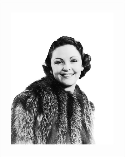 1930s 1940s Portrait Smiling Woman Wearing Fur Coat Looking At Camera by Corbis