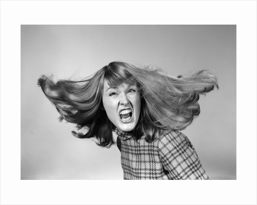 1960s Angry Woman Yelling Gnashing Teeth Hair Flying Looking At Camera by Corbis