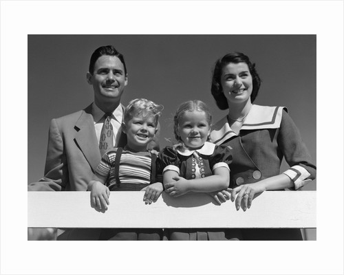 1950s portrait smiling family father mother daughter son standing together behind white fence outdoor by corbis