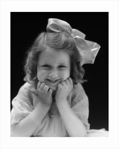 1930s Portrait Smiling Brunette Girl With Big Ribbon Bow In Her Hair Looking At Camera by Corbis