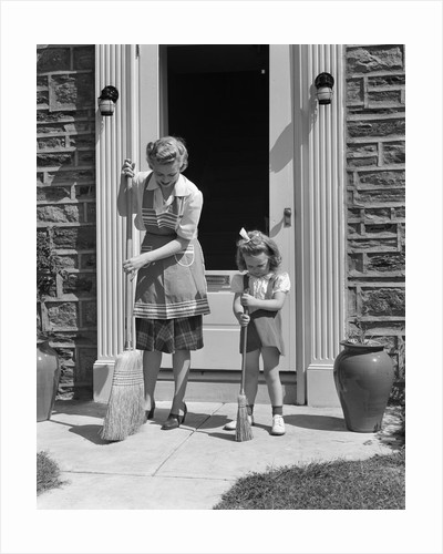 1940s Mother And Daughter Sweeping Sidewalk In Front Of Home by Corbis
