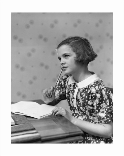 1930s Teenage Girl Thinking Sitting At Table Doing Homework by Corbis
