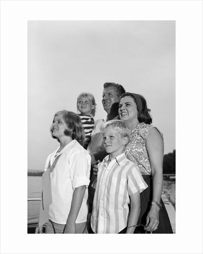 1960s Smiling Family Portrait Father Mother Two Daughters Son Standing Together Outdoors by Corbis