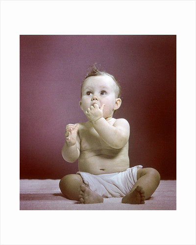 1940s 1950s Baby Diaper Sitting Looking Up Fingers In Mouth by Corbis
