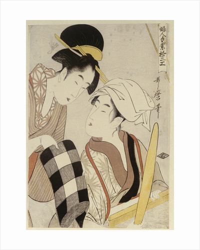 A half-length portrait of two women, one seated at a loom and the other showing a roll of black and white checkered cloth by Kitagawa Utamaro