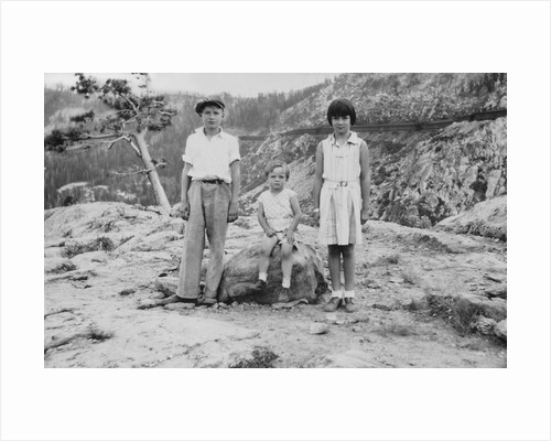 Three siblings pose at Donner Pass on vacation, ca. 1938 by Corbis