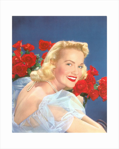 Fifties blonde with roses by Corbis