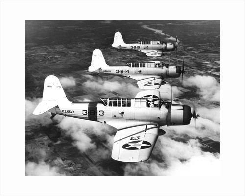 1940s three World War II US navy dive bombers flying in formation by Corbis