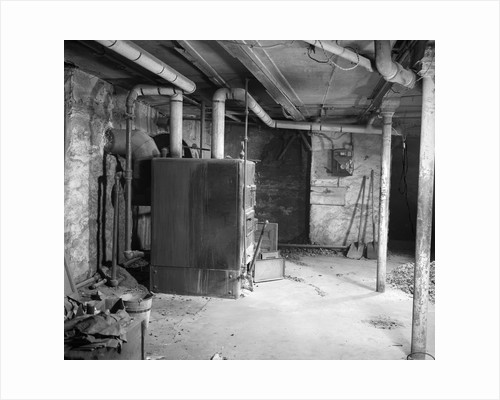 1930s 1940s coal burning home furnace in basement by Corbis