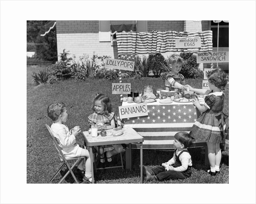 1950s kids in backyard playing store by Corbis