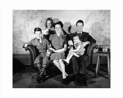 1930s 1940s family of five on a couch by Corbis