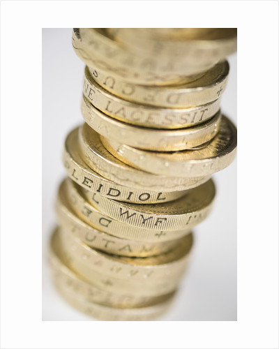 A pile of pound coins on a table by Corbis