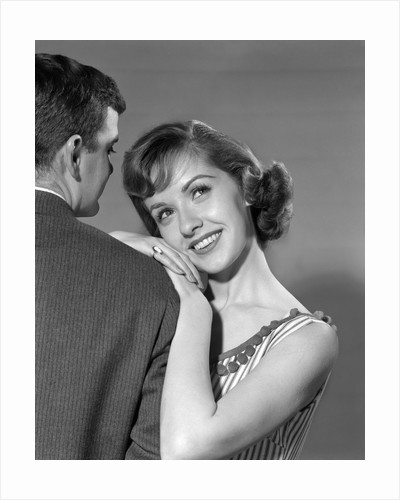1950s woman resting on man's shoulder by Corbis
