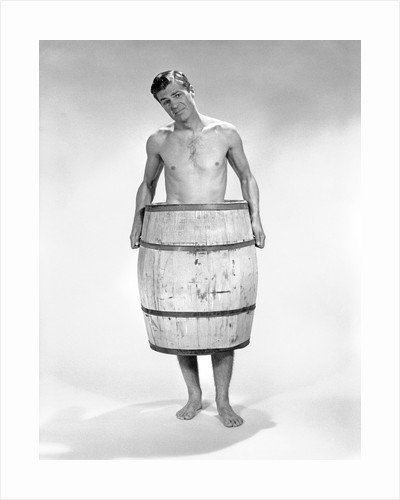 1960s distressed naked man wearing a barrel by Corbis