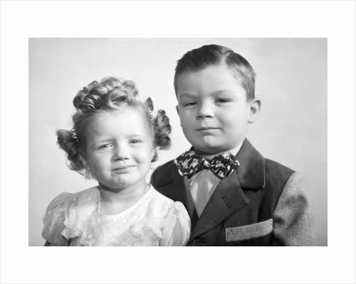 Brother and sister studio portrait, ca. 1949. by Corbis
