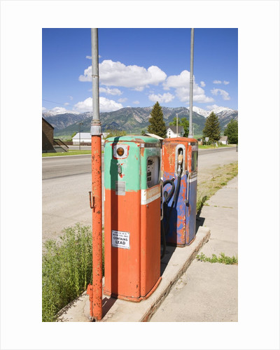 Multi-colored antique gas tanks, Idaho by Corbis