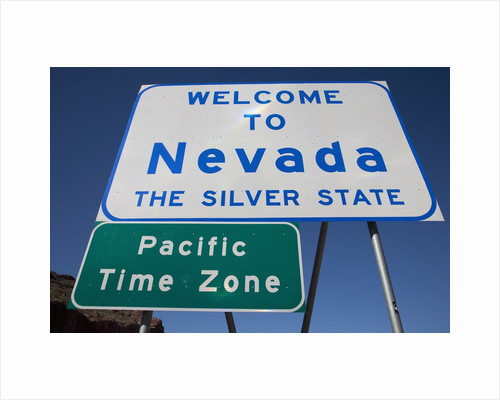 """Welcome to Nevada - the Silver State Road sign and """"Pacific Time Zone"""" sign by Corbis"""