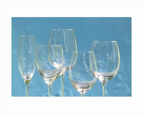 Empty wine glasses by Corbis