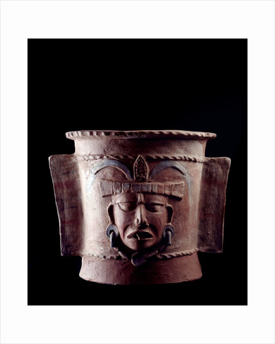 Funeral urn decorated with a human face by Corbis