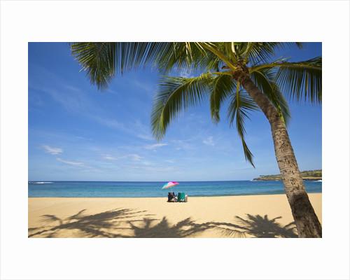 Vacationing couple's beach chair and umbrella on Hulupo'e Beach; Manele Bay; Lanai; Hawaii by Corbis