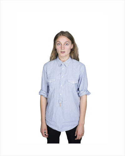 Portrait of teenage girl (16-17) on white background by Corbis