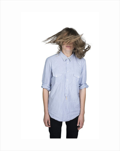 Teenage girl (16-17) shaking her head by Corbis
