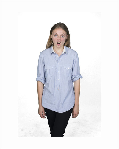 Woman pulling funny face by Corbis