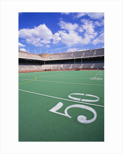 50 Yard Line on Empty Football Field by Corbis