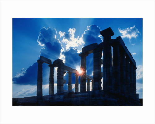 Sun Behind Temple of Poseidon by Corbis