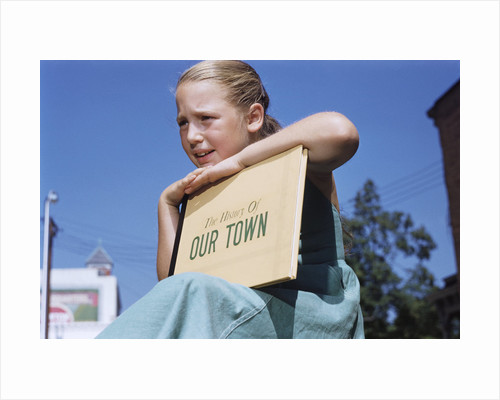 Girl Holding Town History Book by Corbis