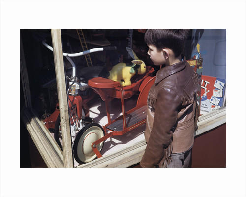 Boy Window Shopping at a Toystore by Corbis