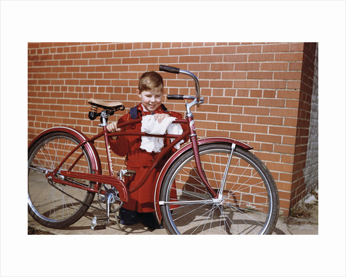Boy Cleaning His Bike by Corbis