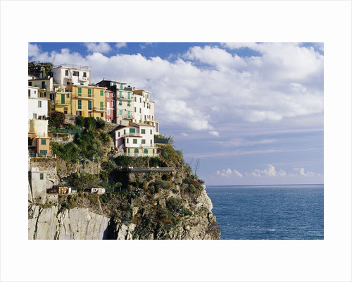 Houses on Sea Cliff in Manarola by Corbis