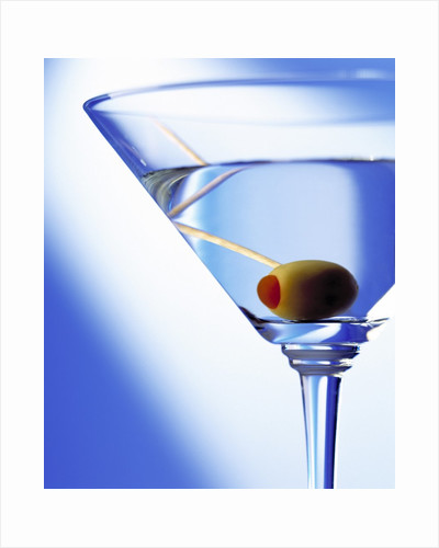 Green Olive in Martini Drink by Corbis