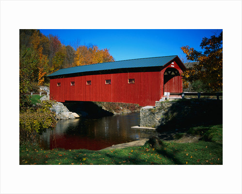 Red Covered Bridge on Rural Road by Corbis