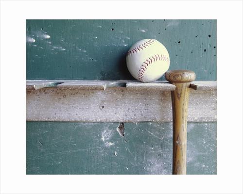 Baseball and Bat on Rack by Corbis