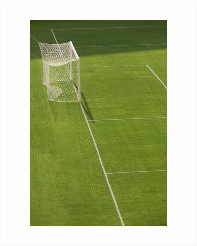 Goal and Net on Empty Soccer Field by Corbis
